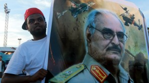 Haftar supporter holds his picture in Benghazi [Reuters]