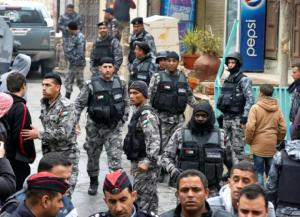 Jordanian policemen leave after ending security operations in the vicinity of Karak Castle