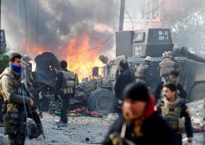 Iraqi Special Operations Forces (ISOF) react after a car bomb exploded during an operation to clear the al-Andalus district of Islamic State militants, in Mosul, Iraq, January 16, 2017.