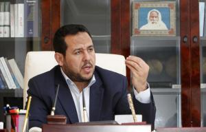 FILE PHOTO - Abdul Hakeem Belhadj, leader of the Al-Watan party, speaks during an interview with Reuters in Tripoli March 4, 2015.