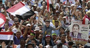 Members of the Muslim Brotherhood and supporters of deposed Egyptian President Mohammed Morsi shout slogans at Rabia al-Adawiya Square in the northeast Cairo suburb of Nasr City, July 8, 2013.