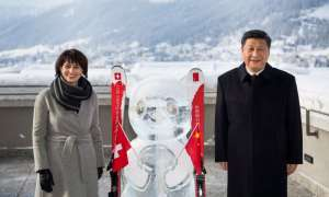 Swiss Federal President Doris Leuthard (left) poses with China's President Xi Jinping (right) during the launch of the Swiss-Sino year of tourism next to a panda ice sculpture on the side line of the 47th annual meeting of the World Economic Forum, WEF, in Davos, Switzerland, 17 January 2017.