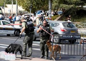 Israeli police secure the area following a shooting incident in what an Israeli police spokesperson described as a terrorist attack, near police headquarters in Jerusalem