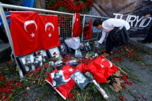 FILE PHOTO - A man places flowers at the entrance of Reina nightclub, which was attacked by a gunman, in Istanbul