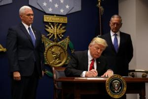 U.S. President Donald Trump signs an executive order he said would impose tighter vetting to prevent foreign terrorists from entering the United States at the Pentagon in Washington