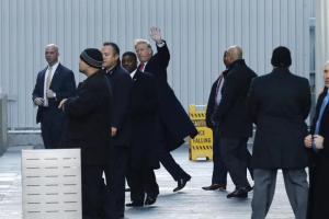 U.S. President-elect Donald Trump (C) exits One World Trade Center following a meeting in Manhattan, New York City, U.S., January 6, 2017. REUTERS/Lucas Jackson