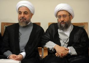 President Hassan Rouhani (L) and Judiciary Chief Sadeq Larijani attending a meeting in Tehran on September 4, 2014. AFP