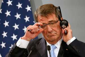 U.S. Defense Secretary Ash Carter reacts during a news conference at the French Defence Ministry in Paris, France, January 20, 2016. The United States has called for defense ministers from all 26 nations participating in the coalition against Islamic State as well as Iraq to gather in Brussels in three weeks time, U.S. Defense Secretary Carter said on Wednesday. REUTERS/Charles Platiau