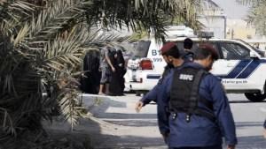 Bahraini police stand guard at a village south of the capital Manama