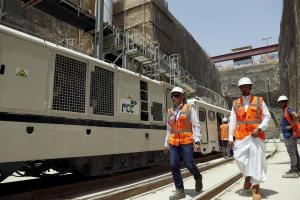 Workers walk at the site of the under-construction Riyadh Metro rail system in the Saudi capital Riyadh August 26, 2015.
