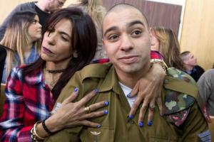 Israeli soldier Elor Azaria is embraced by his mother at the start of is sentencing hearing at a military court in Tel Aviv, Israel February 21, 2017. REUTERS/Jim Hollander/Pool