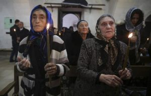 Syriac Christians from Turkey and Syria attend a mass at the Mort Shmuni Syriac Orthodox Church in the town of Midyat, in Mardin province of southeast Turkey in this February 2, 2014 file photo.