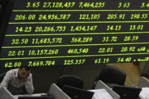A trader works at the Egyptian stock market in Cairo, October 28, 2008.