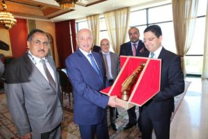 Ageela Saleh, accompanied by Libyan ambassador Abdulmajed Seif El Nasr (left), presented by Moroccan foreign minister Nasser Bourita with a trophy to mark his visit, Libya