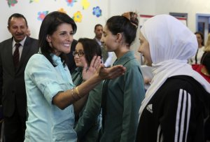 US Ambassador to the United Nations Nikki Haley, second left, meets with Syrian refugee students, in Amman, Jordan, Sunday, May 21, 2017.