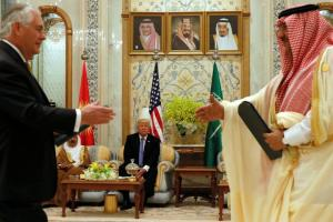 Trump looks on as Tillerson and Saudi Arabia's Crown Prince Muhammad bin Nayef exchange a memorandum of understanding at the Gulf Cooperation Council leaders summit in Riyadh