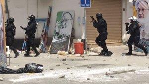 Bahraini security forces during a raid, in Diraz, Bahrain, Tuesday, May 23, 2017