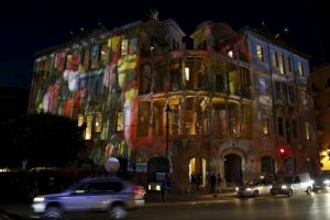 The historic Beit Beirut building is seen illuminated during a ceremony marking the end of its restoration in Beirut