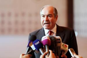 Jordan's new Prime Minister Hani al-Mulqi speaks to the media after the swearing-in ceremony for the new cabinet at the Royal Palace in Amman