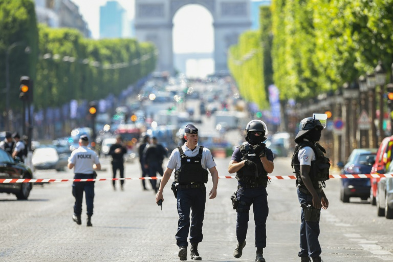 Driver Rams Explosives-Laden Car into Police Vehicle on Champs Elysees in Paris