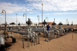 A worker checks pipes and valves at Amaal oil field in eastern Libya October 7