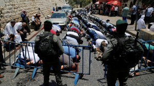 Palestinians pray just outside Jerusalem's Old City in protest over the installation of metal detectors placed at an entrance to the compound that houses Al Aqsa mosque, on July 17, 2017