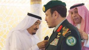 King Salman decorates Mutairi with his new rank. Sunday July 23 SPA