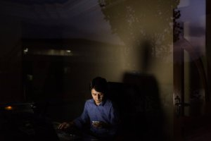 Zaki Daryabi, the founder of Etilaat e Roz, scrolling through the day's news one evening at his office in Kabul.