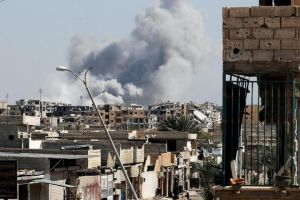 Smoke rises near the stadium where the Islamic State militants are holed up after an air strike by coalition forces at the frontline, in Raqqa, on Oct 12, 2017