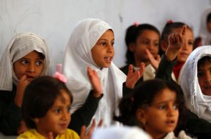 Yemeni students attend a class on the first day of the new school year in the capital Sanaa, on October 15, 2017