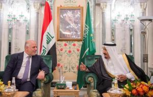 Saudi Arabia's King Salman bin Abdulaziz Al Saud talks with Iraqi Prime Minister Haider al-Abadi in Jeddah