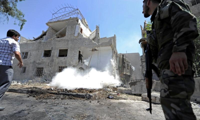 Suicide Attacks Hit Damascus Police Center