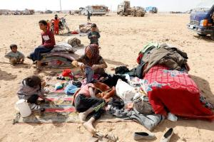 People displaced in fightings between the Syrian Democratic Forces and Islamic State militants are pictured at a refugee camp in Ain Issa