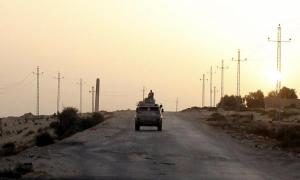 File photo of an Egyptian military vehicle on the highway in northern Sinai