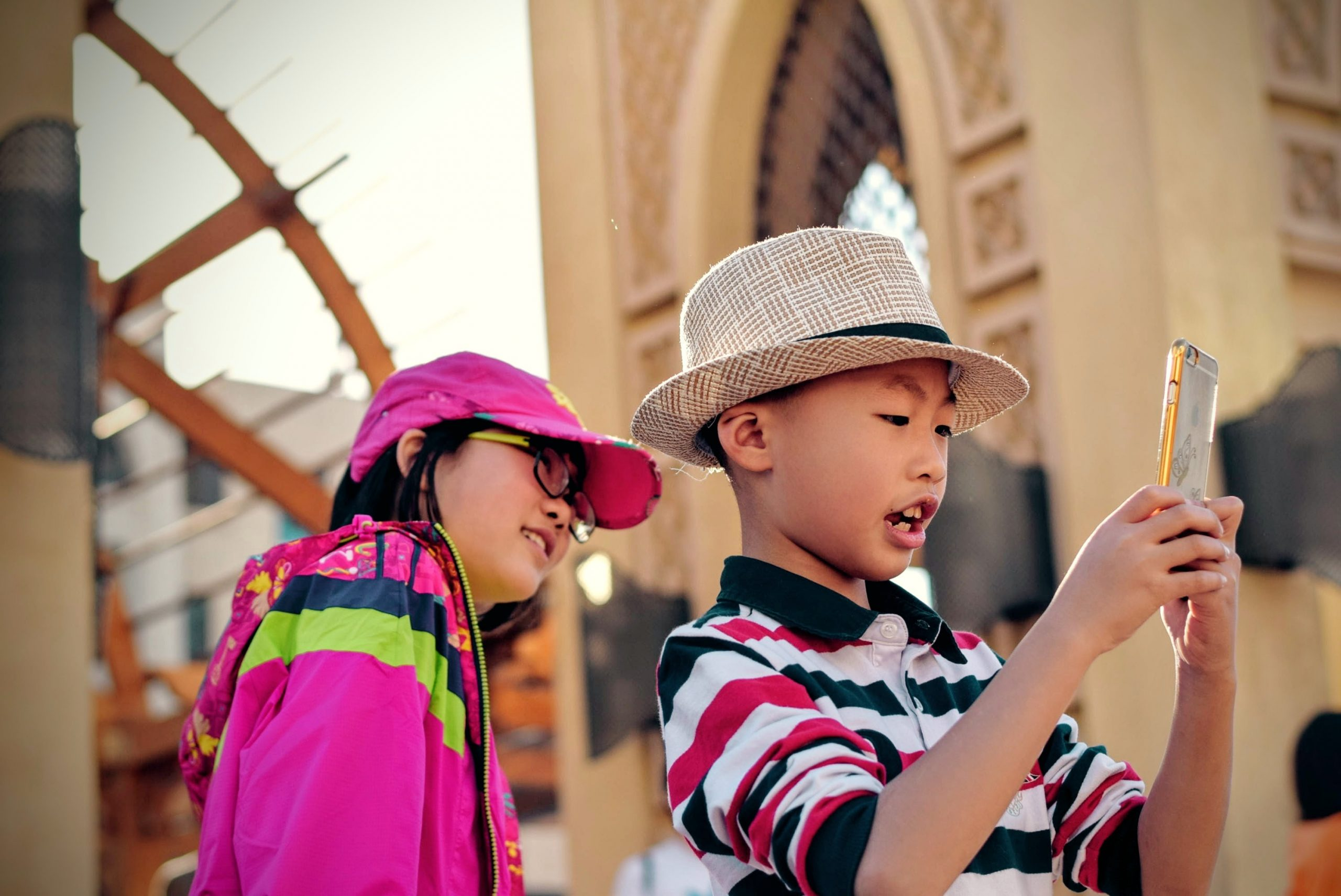Two children looking at a smartphone