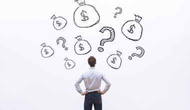 man standing in front of sketched bags of money and question marks