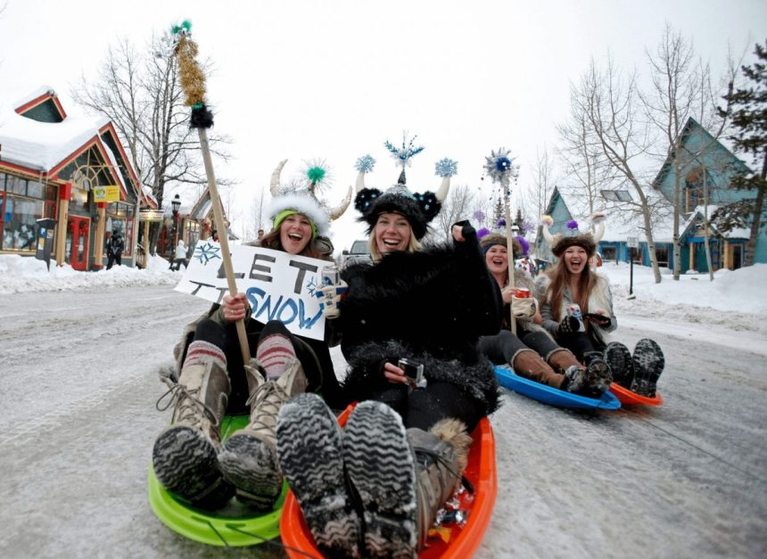 sledding-down-main-street-at-ullr-fest-in-breckenridge