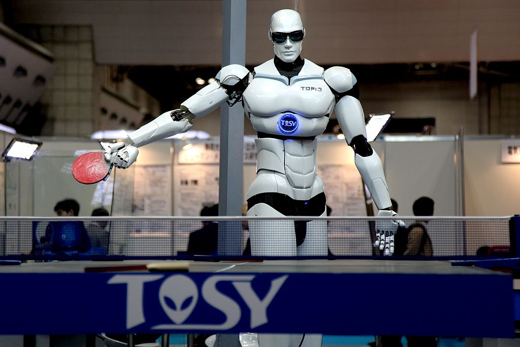 "TOPIO (""TOSY Ping Pong Playing Robot"") is a bipedal humanoid robot designed to play table tennis against a human being. TOPIO version 3.0 at Tokyo International Robot Exhibition, Nov 2009"