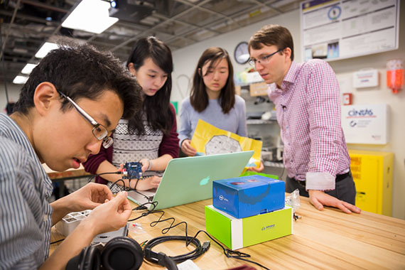 Björn Hartmann (right) working with students in the Invention Lab. Photo by Matt Beardsley.