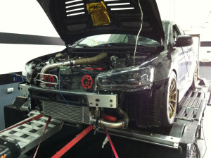 2010 Evolution GSR high-horsepower test vehicle on dyno with aftermarket intercooler