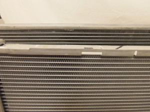 Comparison of cores: Mishimoto E90 radiator prototype 2 (top) and stock radiator (bottom)