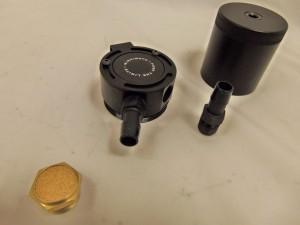 Mishimoto Compact Baffled Catch Can top disassembled