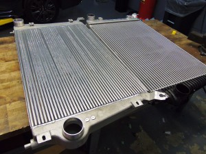 Mishimoto prototype LML Duramax intercooler (left) and factory intercooler (right)