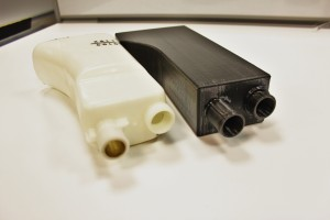 Stock expansion tank (left) and 3D-printed Mishimoto expansion tank prototype (right)