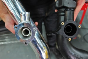 Mishimoto hot-side intercooler pipe BPV flange (left) and stock BPV flange (right)