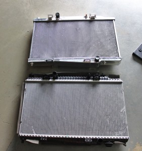 Mishimoto prototype Ford Fiesta ST radiator (top) and stock Fiesta ST radiator (bottom)