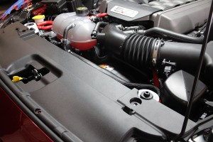 Driver-side Mustang catch can installed with other Mustang parts