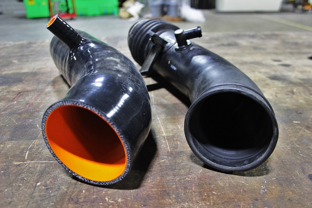 Mishimoto 350Z intake hose (left) and stock hose (right)