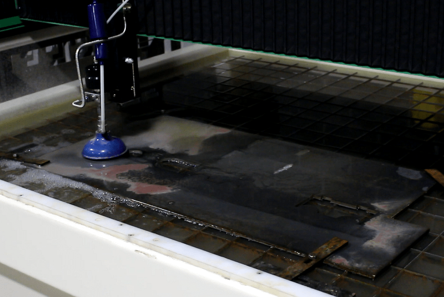 Cutting our Mustang H-pipe jig on the waterjet