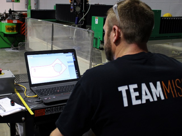 Mike uses the WARDJet software to map the cutting path for a bracket